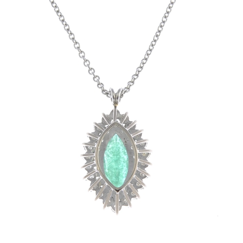 55 - An 18ct gold emerald and diamond cluster pendant. The marquise-shape emerald, with brilliant-cut dia...