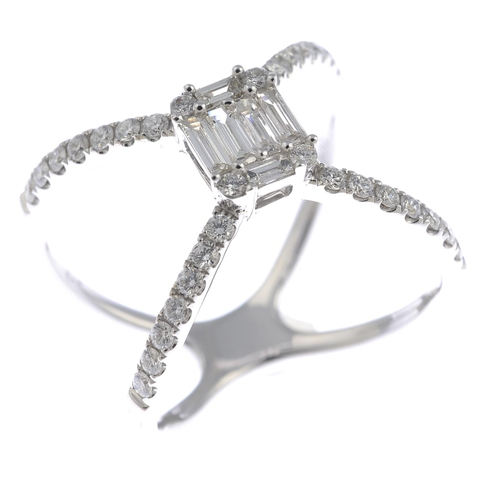 58 - A diamond dress ring. The vari-cut diamond rectangular cluster, to the brilliant-cut diamond line op...