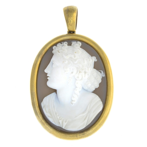9 - A late Victorian 18ct gold agate cameo locket. The oval onyx, carved to depict a lady in profile, su...