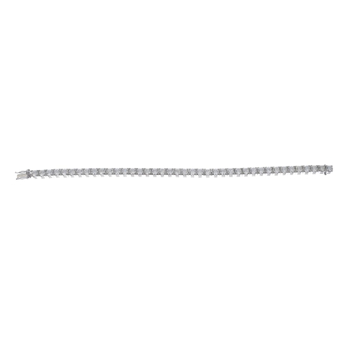 34 - A diamond line bracelet. Designed as a brilliant-cut diamond line, with partially concealed clasp. T...