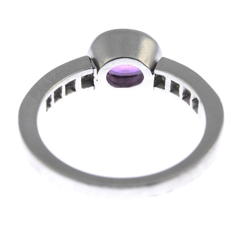 35 - A platinum sapphire and diamond ring. The oval-shape pink sapphire collet, with square-shape diamond...
