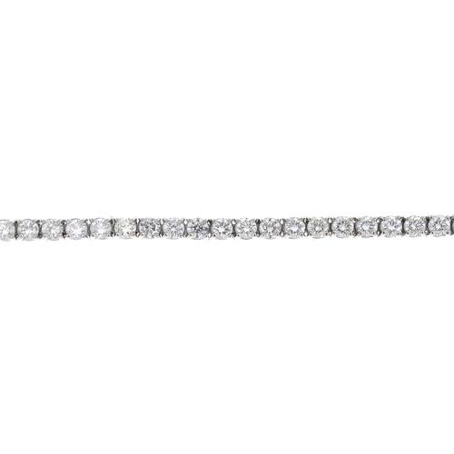 36 - A diamond bracelet. The brilliant-cut diamond line, with partially concealed clasp. Estimated total ...