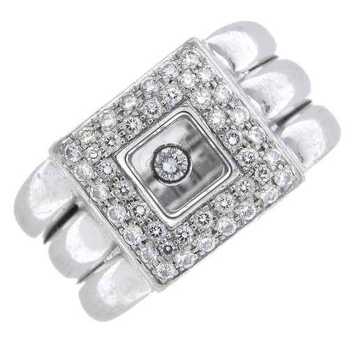 40 - CHOPARD - a 'Happy Diamonds' ring. The brilliant-cut diamond collet, free moving within a pave-set d...
