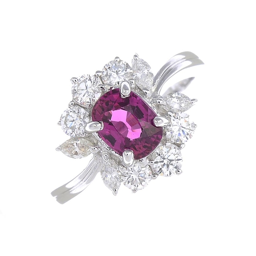 41 - A ruby and diamond cluster ring. The cushion-shape ruby, with brilliant-cut and marquise-shape diamo...