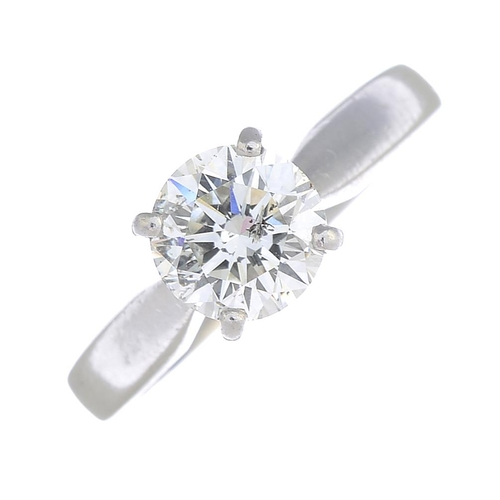 43 - A platinum diamond single-stone ring. The brilliant-cut diamond, with tapered shoulders. Estimated d...