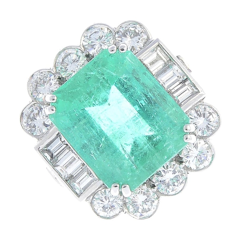 45 - A Colombian emerald and diamond ring. The rectangular-shape emerald, with baguette-cut diamond bar a...