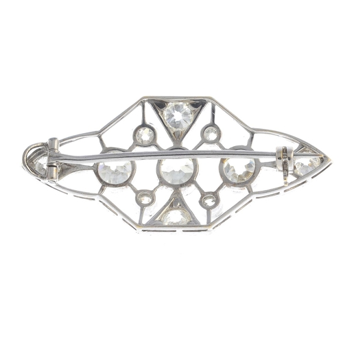 47 - A diamond brooch. The old-cut diamond collet line, to the openwork lattice, with similarly-cut diamo...