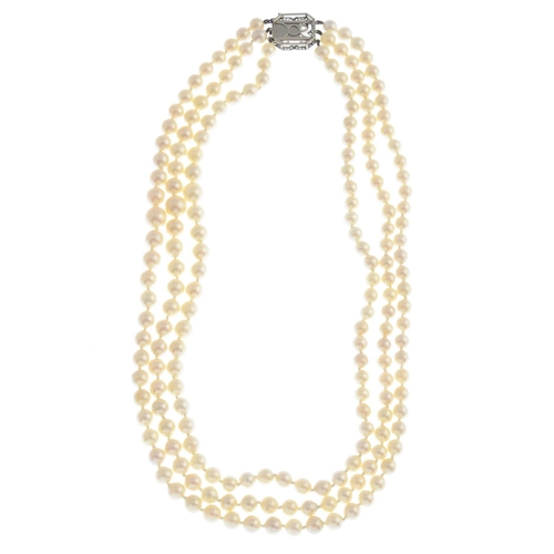 49 - A cultured pearl necklace. Comprising three strands of cultured pearls, measuring approximately 8.9 ...
