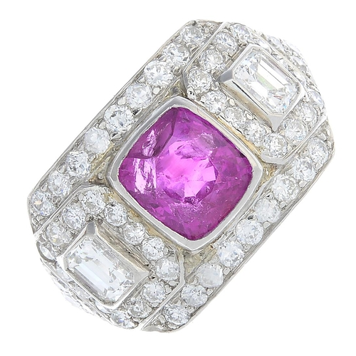 51 - A Burmese ruby and diamond ring. The cushion-shape ruby, with baguette and brilliant-cut diamond clu...