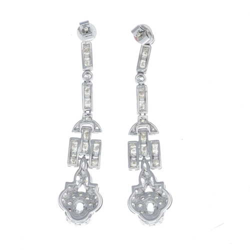 53 - A pair of diamond earrings. Each designed as a pear-shape and brilliant-cut diamond cluster, with br...