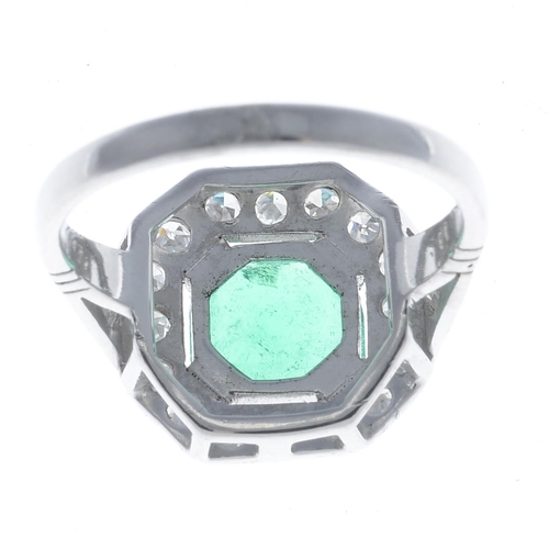 54 - A Colombian emerald and diamond ring. The octagonal-cut emerald, weighing 1.42cts, to the single-cut...