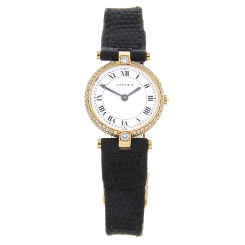 52 - CARTIER - a Vendome wrist watch. 18ct yellow gold diamond set case. Numbered 810024414. Signed quart...