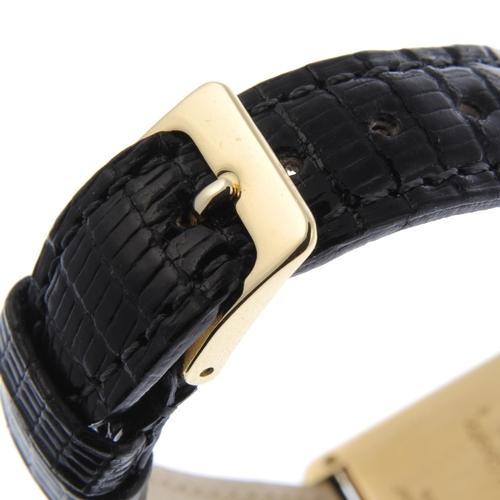 60 - CARTIER - a Must de Cartier Tank Louis wrist watch. Yellow metal case, stamped 18K 750 with poincon....