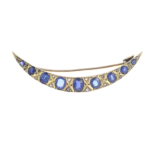 4 - An early 20th century gold, graduated sapphire crescent brooch, with rose-cut diamond spacers and te...