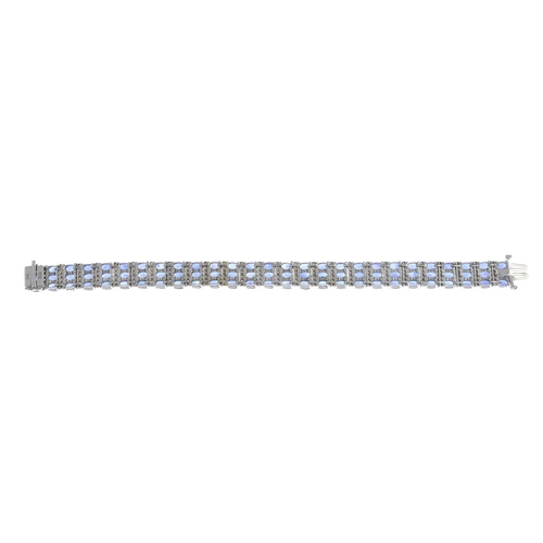 9 - A sapphire and diamond bracelet.Estimated total diamond weight 1.65cts.Stamped 14K.Length 18cms. 31....