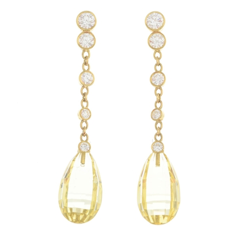 11 - A pair of 18ct gold heliodor and diamond earrings. Estimated total diamond weight 0.75ct, principal ...