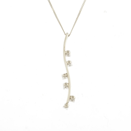 12 - An 18ct diamond pendant, suspended from a 9ct gold flat curb-link chain.Estimated total diamond weig...