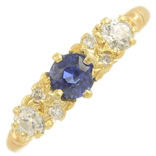 14 - A sapphire and diamond dress ring.Estimated total diamond weight 0.20ct.Ring size L. 2.4gms....