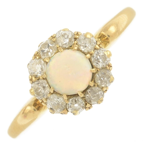 15 - An early 20th century 18ct gold opal and diamond cluster ring.Estimated total diamond weight 0.40ct....