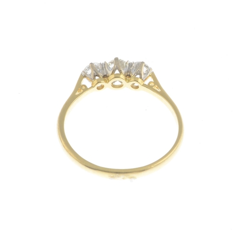 30 - An 18ct gold diamond three-stone ring.Estimated total diamond weight 0.50ct, H-J colour, SI-P1 clari...