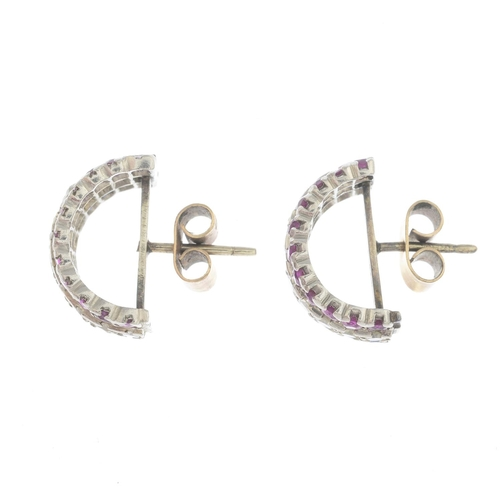 41 - A pair of sapphire, ruby and diamond half-hoop earrings. Estimated total diamond weight 0.80ct, H-I ...