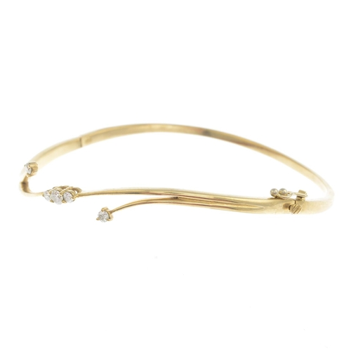 48 - A 9ct gold diamond bangle and a 9ct gold diamond dress ring.Hallmarks for Birmingham and London.Esti...