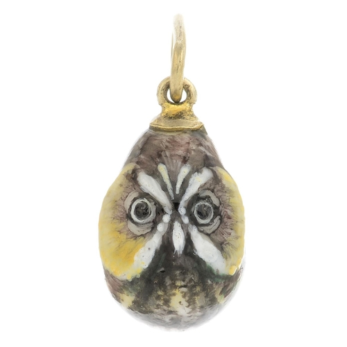 5 - An early 20th century enamel egg pendant, painted to depict an owl.Length 2.3cms. 2.1gms....
