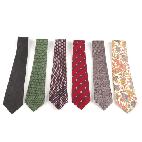 10 - BALENCIAGA - six ties. To include a floral paisley tie on a cream background, a red and blue striped...