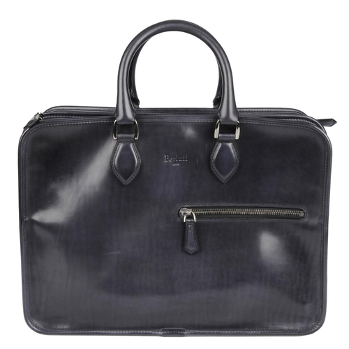 12 - BERLUTI - a leather Deux Jours briefcase. Crafted from polished navy blue leather, featuring rolled ...
