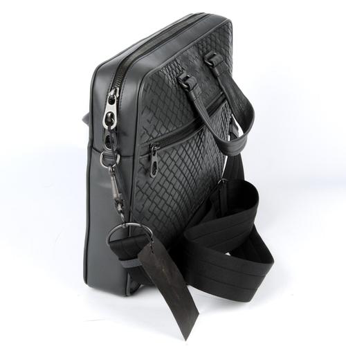 13 - BOTTEGA VENETA - an Ardoise Intrecciato Aurelio briefcase. Designed with an embroidered and woven ca...