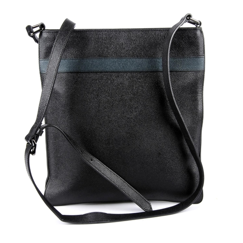 25 - BURBERRY - a leather crossbody messenger bag. Featuring a black textured leather exterior with teal ...