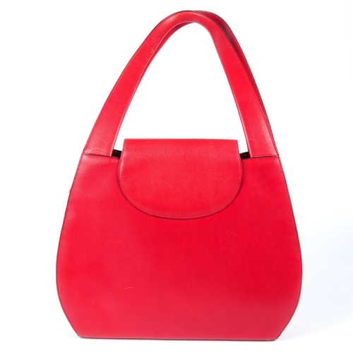 36 - CARTIER - a red Panthère handbag. Crafted from grained red leather, with rigid looping top handles, ...