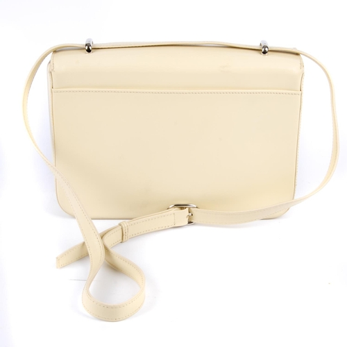 37 - CARTIER - a cream Panthère Flap handbag. Crafted from smooth cream leather, with an adjustable two-w...
