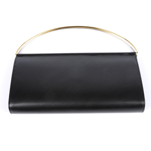 40 - CARTIER - a Trinity purse. Designed with a black leather exterior, multi-toned dual ring handles, op...