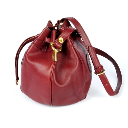 45 - CARTIER - a Must De Cartier Tulip bucket bag. Designed with maker's classic burgundy leather exterio...