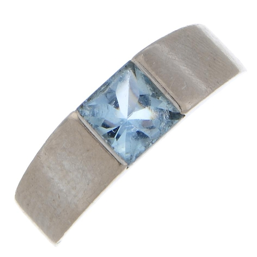 54 - CARTIER - an 18ct gold topaz 'Tank' ring. The square-shape fancy-cut blue topaz, to the tapered side...
