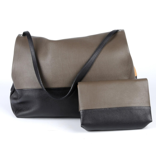 58 - CÉLINE - an All Soft Tote and pouch. Featuring a black and grey soft calfskin leather exterior, with...
