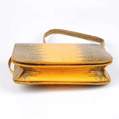 59 - CÉLINE - a lizard skin Classic Box Flap handbag. Crafted from mustard yellow and black lizard skin w...