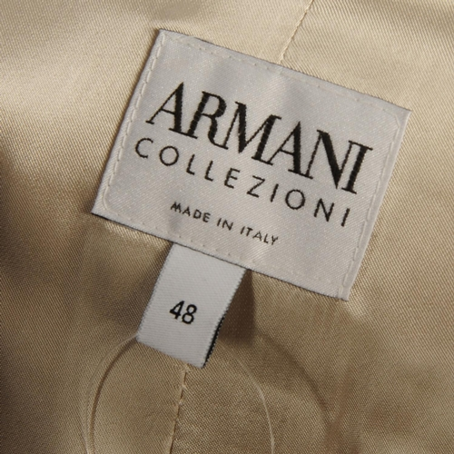 7 - ARMANI COLLEZIONI - a pale grey knee-length coat. Crafted from pale grey, crepe virgin wool mix into...
