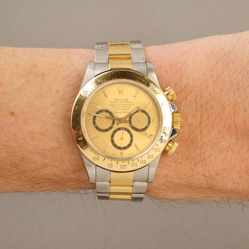 220 - ROLEX - a gentleman's Oyster Perpetual Cosmograph Daytona chronograph bracelet watch retailed by Tif...