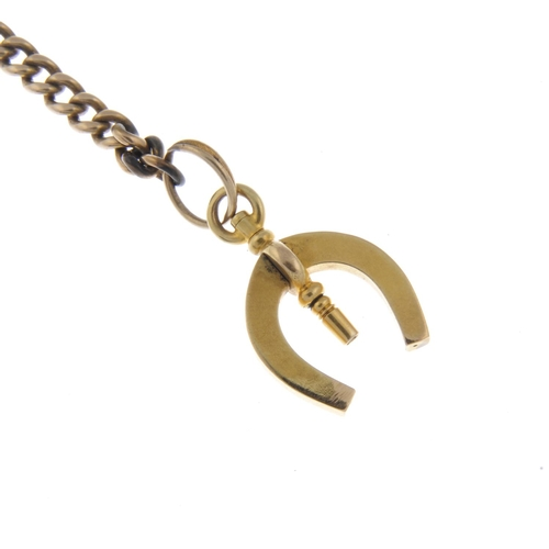 315 - A yellow metal curb link Albert chain, with T-bar and horseshoe fob. Total weight 48gms. Total lengt...