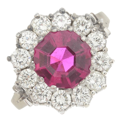 23 - A synthetic ruby and diamond cluster ring.Estimated total diamond weight 1.20cts, I-K, colour, SI cl...