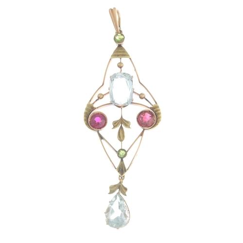 3 - An early 20th century Russian gold aquamarine, demantoid garnet and ruby pendant.Principal aquamarin...
