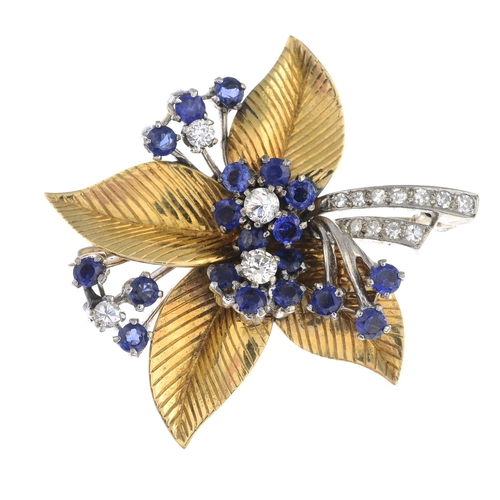 52 - A sapphire and diamond foliate brooch. Estimated total diamond weight 0.50ct.Length 4cms. 15.4gms....