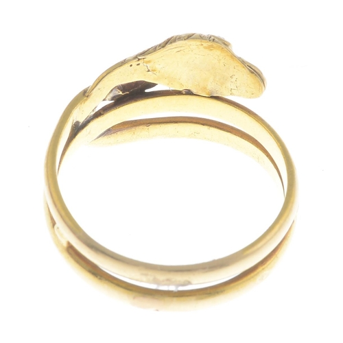 57 - An early 20th century gold diamond snake ring.With French marks.Ring size J. 2.9gms....