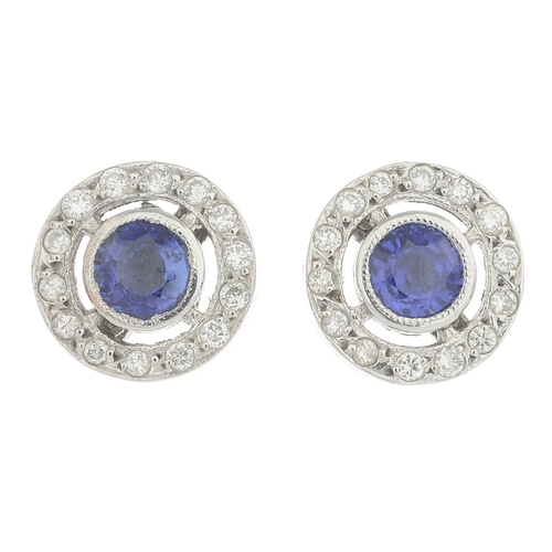 6 - A pair of sapphire and diamond cluster earrings.Estimated total diamond weight 0.20ct.Stamped 750.Di...