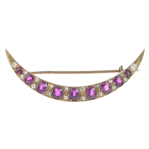 31 - A late Victorian gold ruby and diamond brooch.Estimated total diamond weight 0.45ct.Length 5.1cms. 4...