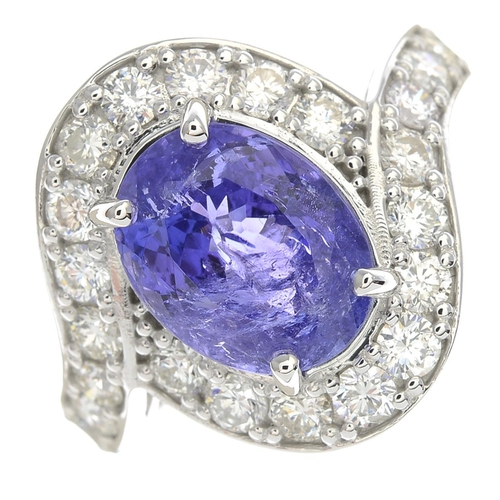 34 - A tanzanite and diamond dress ring.Tanzanite calculated weight 3.46cts, based on estimated dimension...