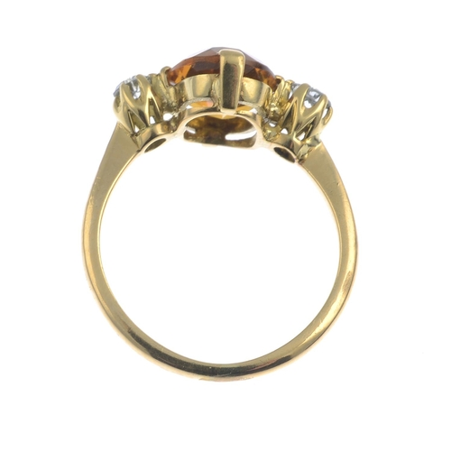 4 - A citrine and diamond three-stone ring.Citrine calculated weight 1.90cts, based on dimensions 10 by ...