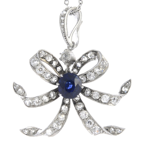 51 - A sapphire and diamond pendant, suspended from a trace-link chain. With report 79195-02, dated 16th ...